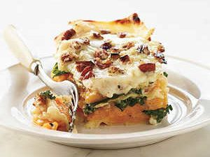 Gruyère-spiked béchamel drapes over the noodles and squash to give Butternut-Kale Lasagna velvety richness. Hearty, earthy kale perfectly balances the sweet squash, and crunchy, toasted pecans crown the top of this luscious lasagna