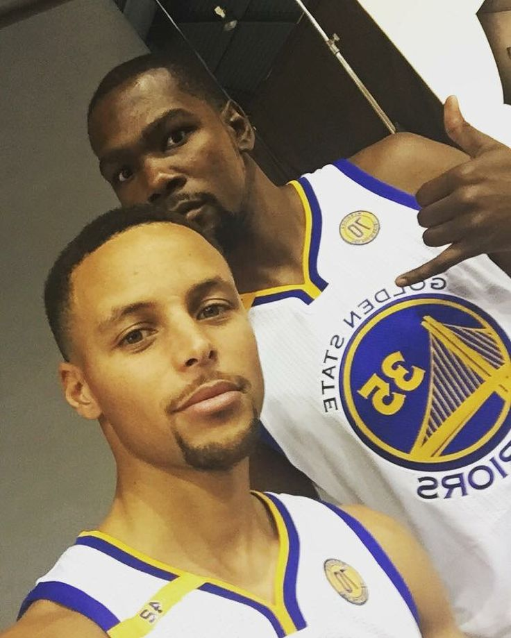 Golden State Warriors' team members Steph Curry, Kevin Durant, Klay Thompson and Draymond Gren pose during media day Monday, Sept. 26, 2016, in Oakland, California