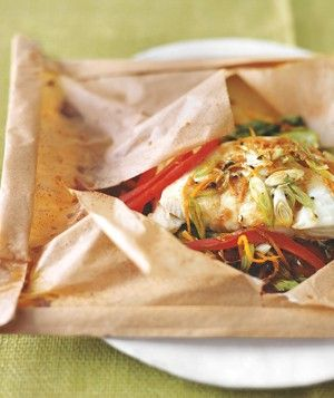 Asian-Style Halibut in Parchment|A combination of steaming and baking, this parchment-paper cooking method works well with fish because the paper pouch traps the moisture and juices. If the seams start to unfold as soon as you let go of the paper, use a lemon half or a piece of carrot or potato as a paperweight. Try more recipes cooked in parchment:  I love this! it is easy to prep for a dinner party and delicious!!