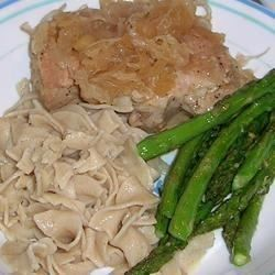 Savory-sweet pork chops are baked with sauerkraut, apple, and brown sugar in this easy and hearty German dish.