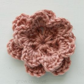 A free crochet pattern for making a two layer flower- perfect for accessorizing hats and earwarmers.