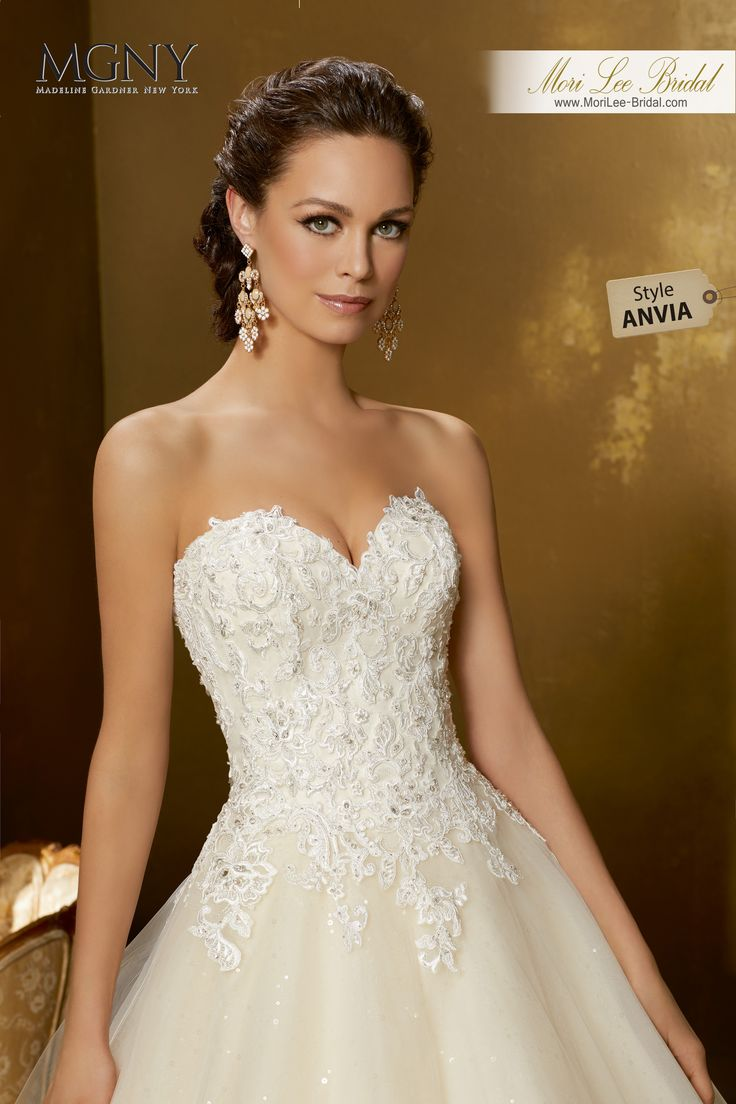 Style ANVIAOridaCrystal beaded alençon lace appliqués on a tulle ball gown with wide hemlace over sequined tulle