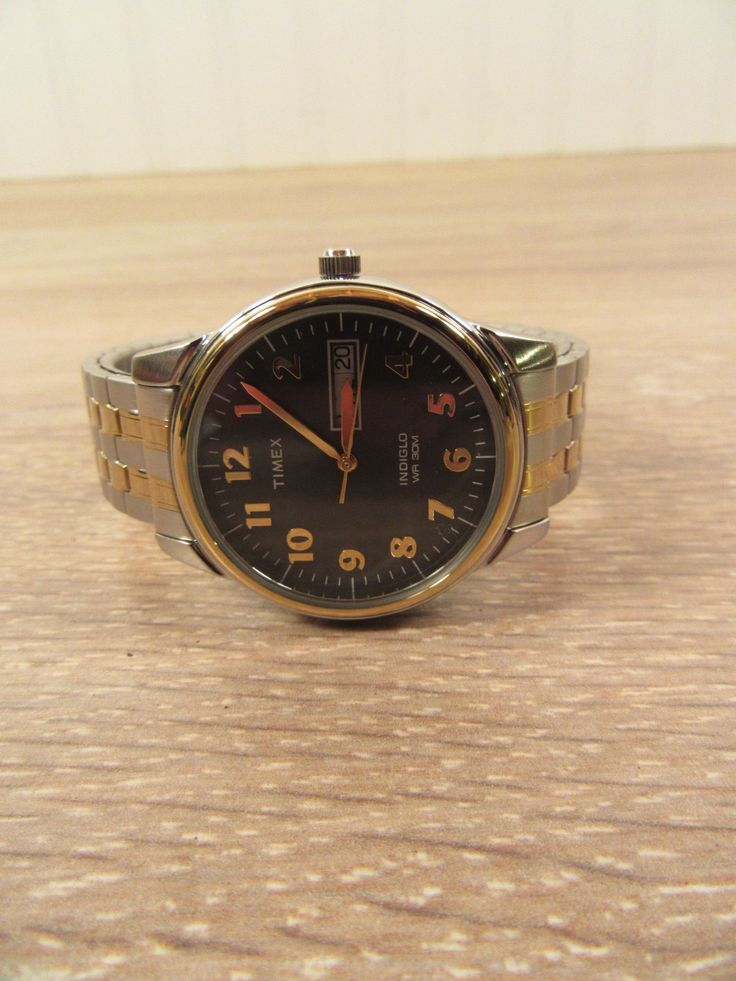Timex silver tone and gold tone indiglo battery operated