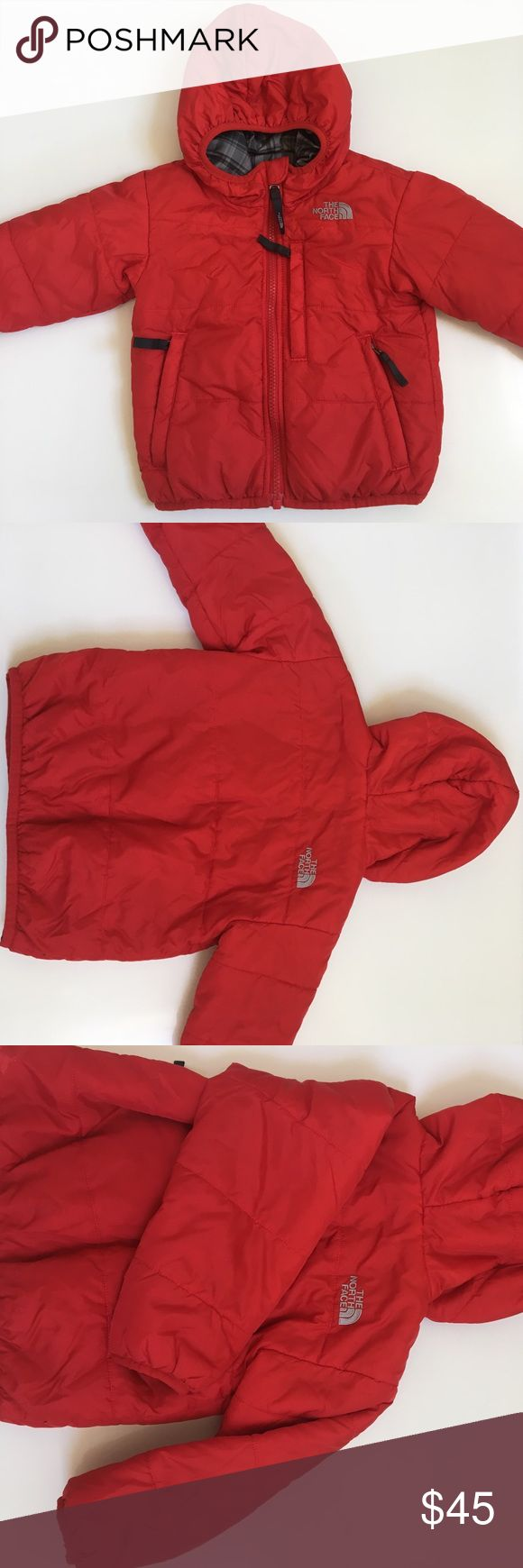 { THE NORTH FACE } Jacket THE NORTH FACE jacket reversible, one side is red with grey accents and other is patterned in grey tones with red accents (please see pictures), both sides have pockets and embroidered labels, soft and a light fluffy puff to this to help keep your little one cozy, hooded. Previously used and has normal wash and wear to it from a little one but in good condition. The North Face Jackets & Coats