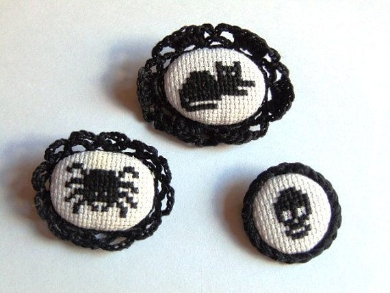 Set of three hand embroidered black brooches in gothic style.