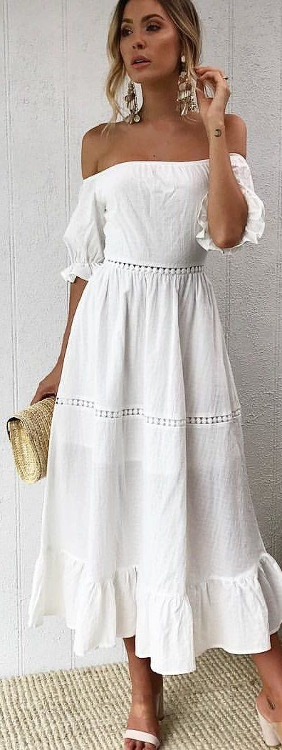 #spring #outfits woman in white off-shoulder dress standing while holding wallet. Pic by @littlelace