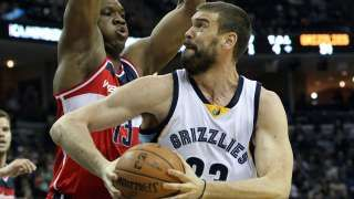 Apr 4, 2015; Memphis, TN, USA; Memphis Grizzlies center Marc Gasol (33) drives against Washington Wizards center Kevin Seraphin (13) in the second quarter at FedExForum. Mandatory Credit: Nelson Chenault-USA TODAY Sports