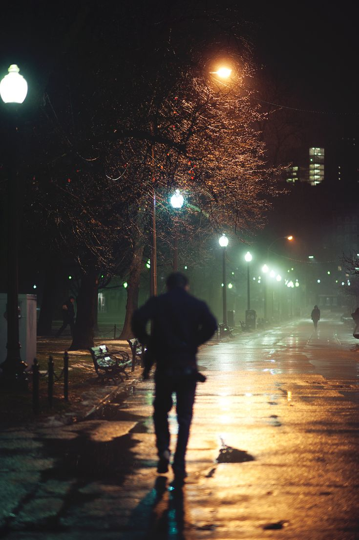 You man walking down the street at night
