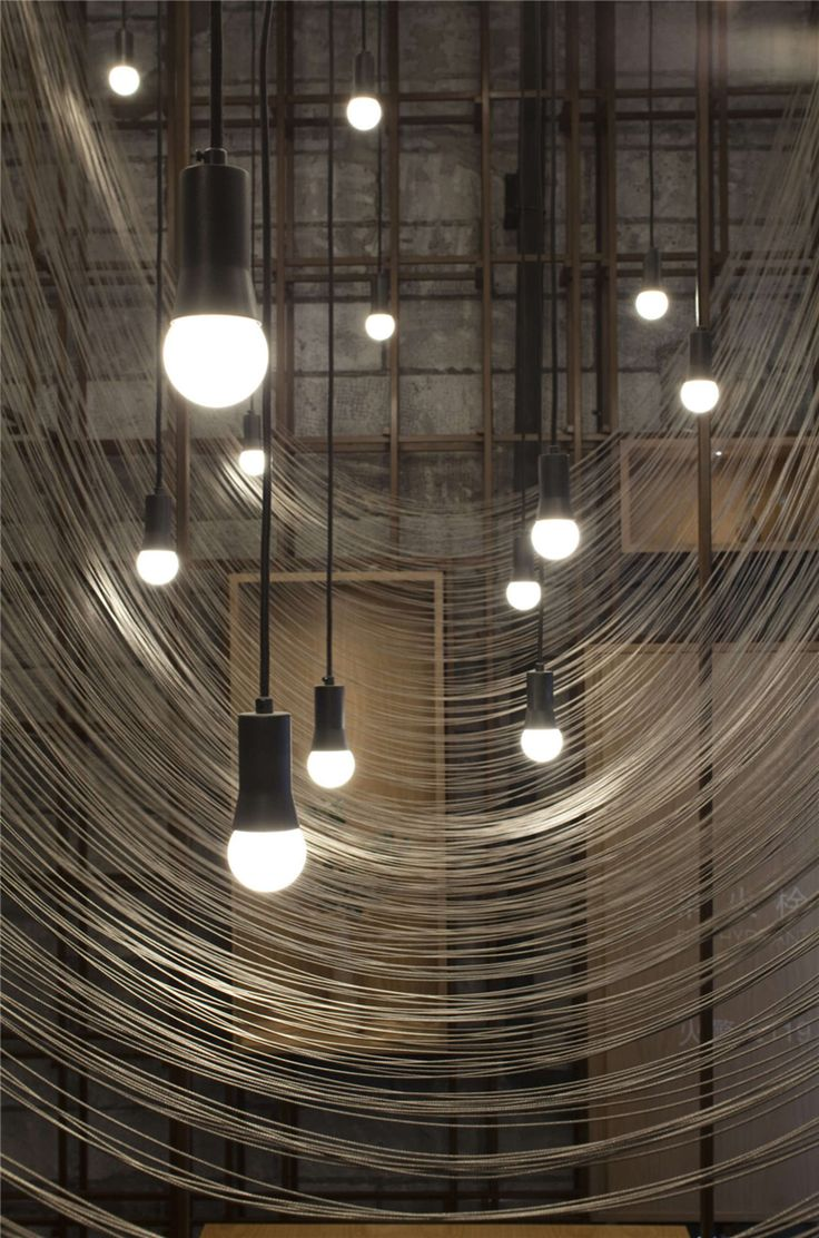 Reflective strands give the appearance of dining under a noodle rack in this Chinese noodle restaurant