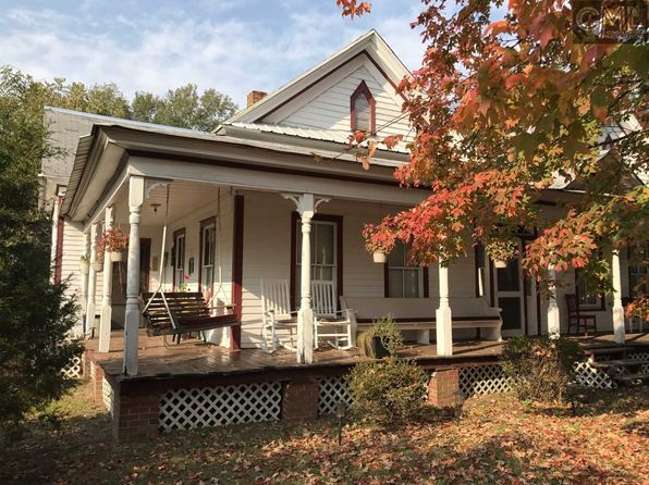 For sale: $124,000. True Southern Charmer! 1912 New Holland FARMHOUSE w/ WRAPAROUND PORCH features 11' Ceilings, Extra-Wide Hallways, Wainscoting, Tung-n-Groove Walls, 4 FIREPLACES and HAND CARVED wood work throughout! Boasts 3 large BR's, 2 Full baths, XL KITCHEN w/ TEAKWOOD cabinets, oversized MUD ROOM, PANTRY and GRAND FOYER. The Refrigerator, W/D and several A/C Window Units (told rarely needed w/ High Ceilings and Energy Efficient WINDOWS) conveys. Includ...