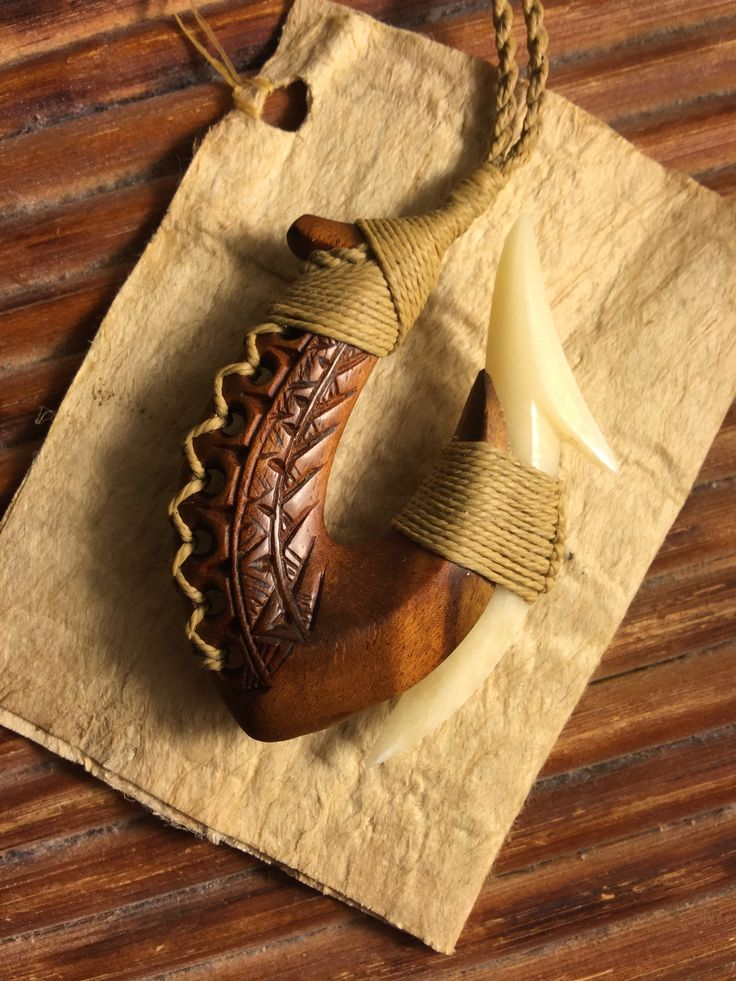 Ifilele wood and cattle bone hook carving by master carver