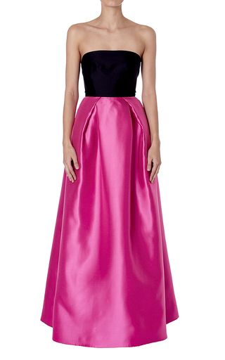 This strapless **Carla Zampatti** gown is rendered in brocade and features a black top and a pink floor length full skirt.
