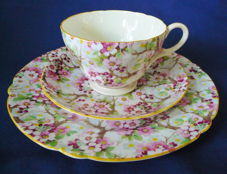 "SHELLEY ENGLAND CHINTZ ~ MAYTIME ~ TRIO SET. : This lovely fine bone china trio set by Shelley England is done in their ""Maytime"" chintz pattern of pink & white tree blossoms & green leaves. The Henley shaped cup has a very pale yellowish cream interior. 