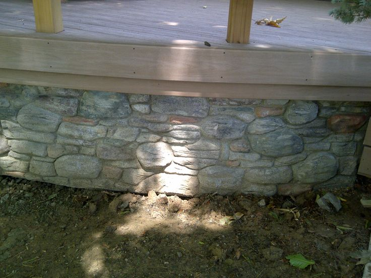 This stone deck skirt was done by Hickory Dickory Decks in Flamborough Ontario in 2013.