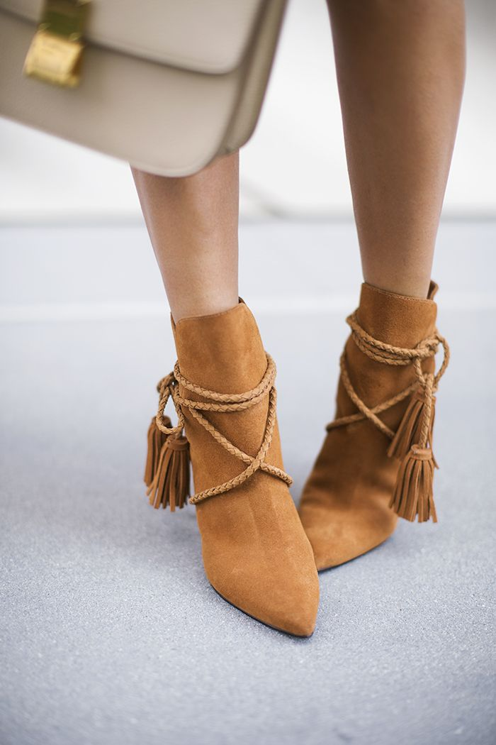 Can't get enough of these suede ankle boots with braided tie details.