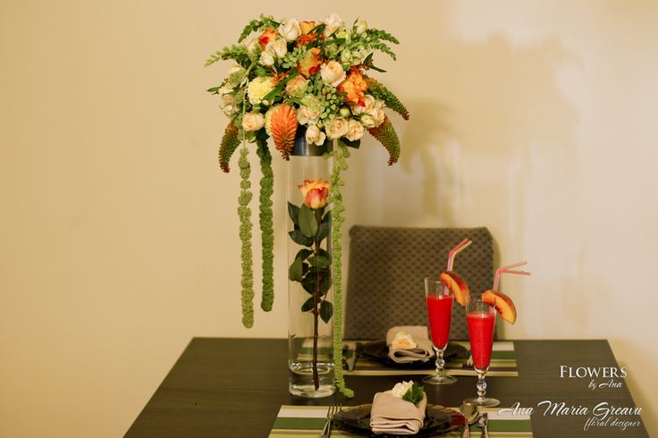 Table decoration with orange-cream flowers Table centerpiece