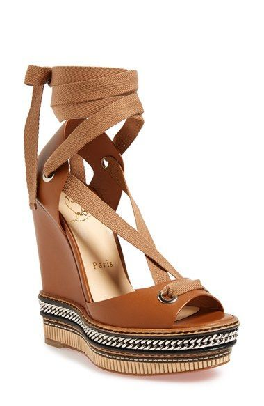 Free shipping and returns on Christian Louboutin 'Tribuli' Wedge Sandal at Nordstrom.com. A chain-wrapped platform grounds a sleek Italian-leather wedge sandal. The iconic red-lacquer sole provides a flash of signature glamour with each self-confident step.