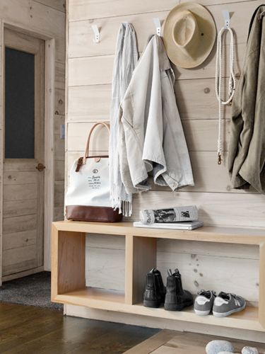 """Elements: Minimal mudroom/ hallway/ foyer design: """"A floating pine shelf offers a spot for bags, shoes, and mail."""" Bobby Houstons Cabin Decor - Modern Cabin Decorating Ideas - Country Living"""