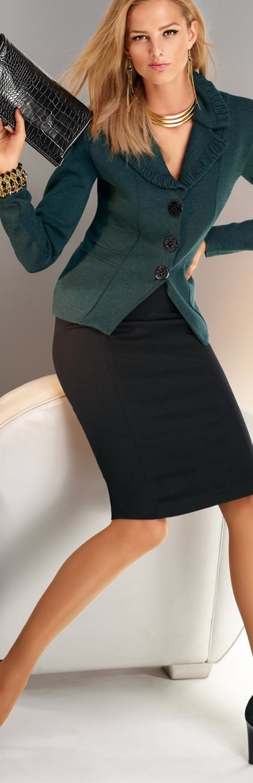 A teal jacket & a black skirt from Madeleine ensure that you're ready for the office.