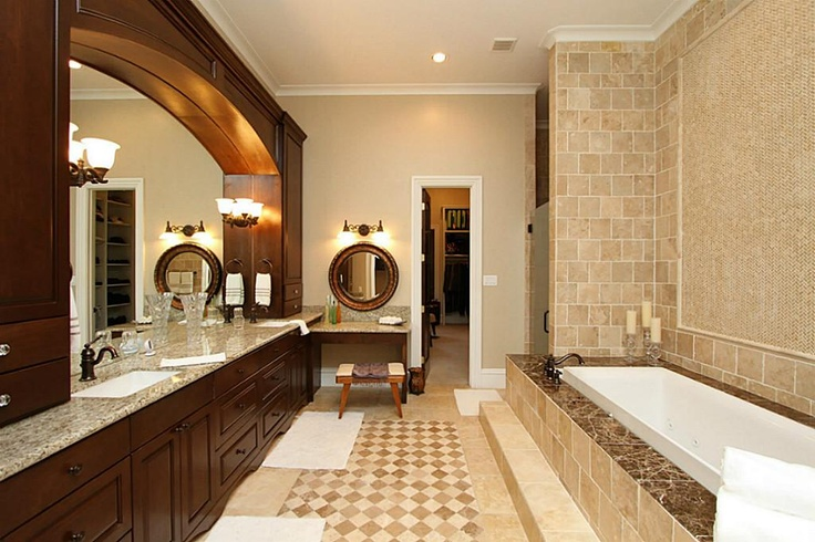 Arched Fur Down Of Cabinets Over Mirrors In Bathroom For