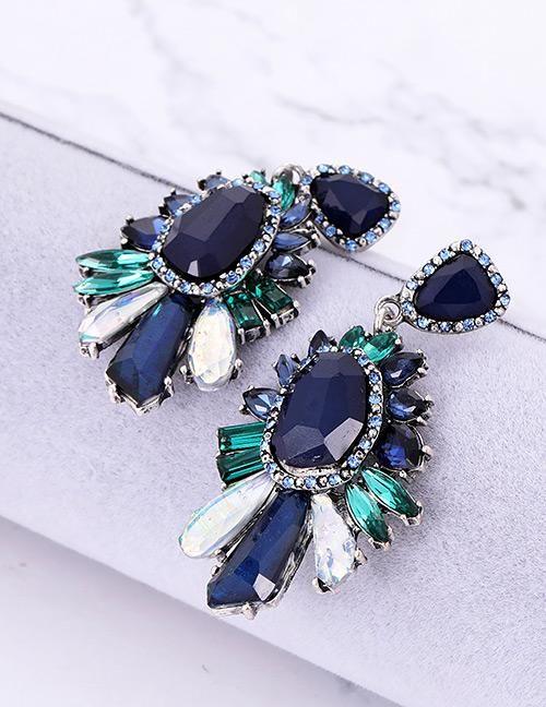 452d93a97b Arete de cristales urban style COLOR Azul, Morado Medida 6.5cm Material  Resina, Cristal