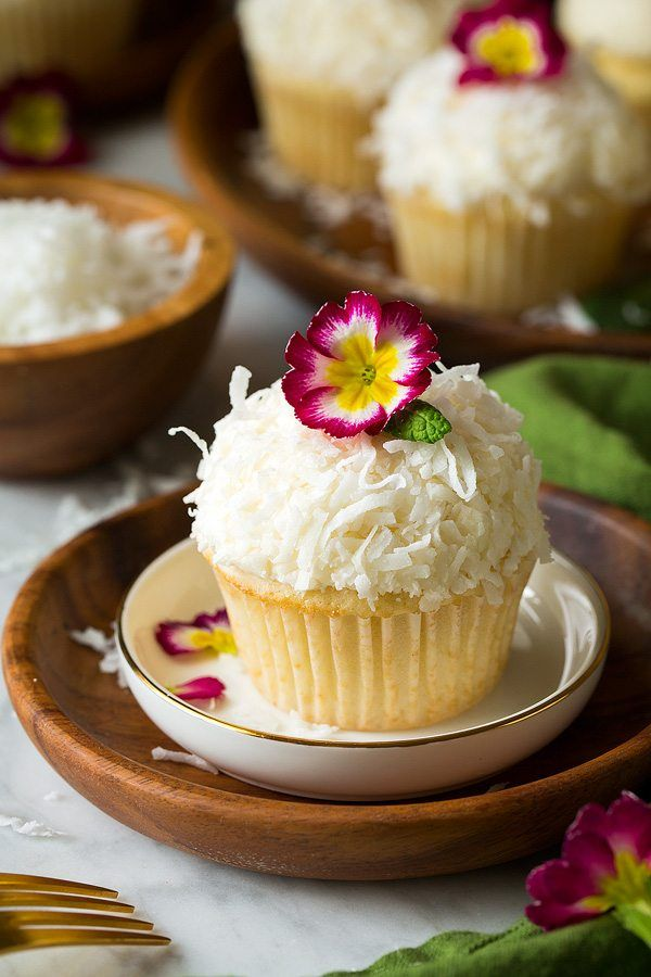 Soft and fluffy coconut cupcakes topped with a rich coconut buttercream frosting. One of the best cupcakes you'll ever taste!