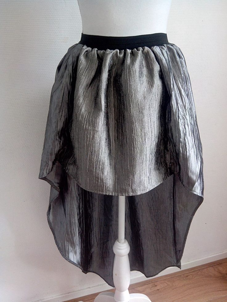 Gorgeous metallic designerskirt! Made of high quality waste textile in Holland.