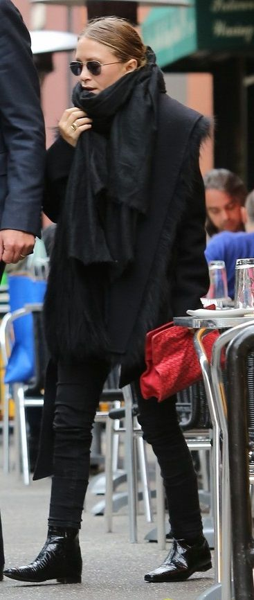 Mary Kate Olsen. All black oversized scarf with boyfriend coat, skinny jeans and boots.