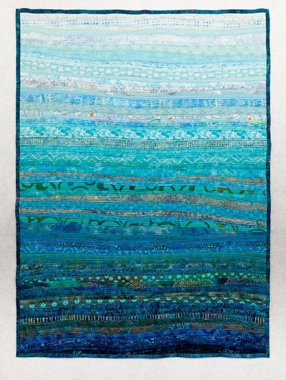 Quilt made of stripes of different shades and tints makes a stunning blue colour study.