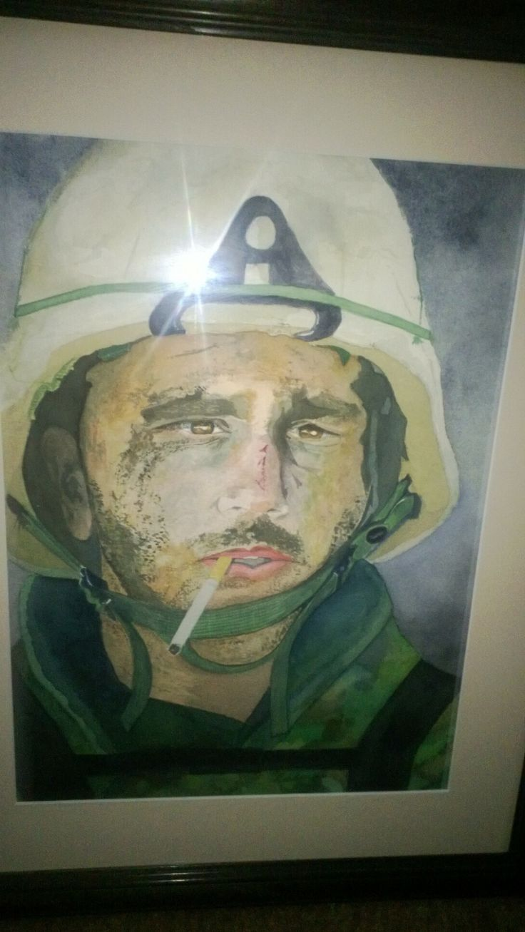 """SMOKIN'!!! - Marine Blake Miller - dubbed the """"MARLBORO MAN"""" - The battle-weary Marine with a cigarette dangling from his mouth. Miller's face was smeared with soot and sand and blood and war paint, none of which could camouflage his bewilderment and exhaustion.  Artist Wally Zuber was inspired to paint the Marlboro Man and sent the finished product to Miller's Mom and Grandparents as a gift. You will also notice Miller's close up tattoed on Wally's arm. Email wallyzuberart@gmail.com"""