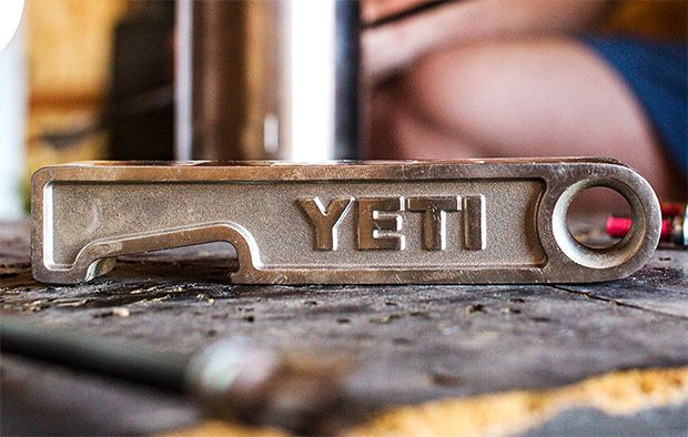 Could make this with a block of hardwood and a piece of steel plate.  YETI Brick Bottle Opener
