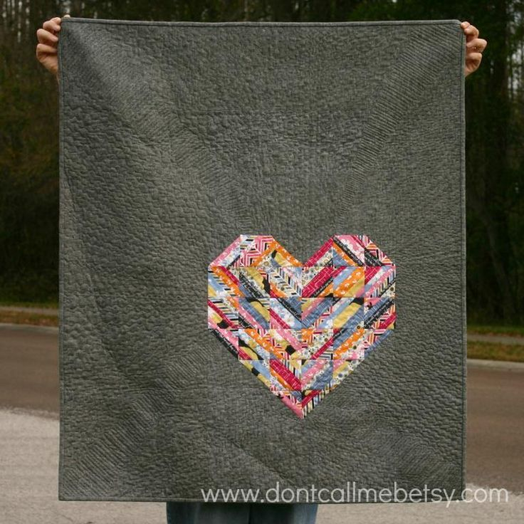 Fabulous design! Large neutral grey background with colorful pieced sorta-log-cabin heart!