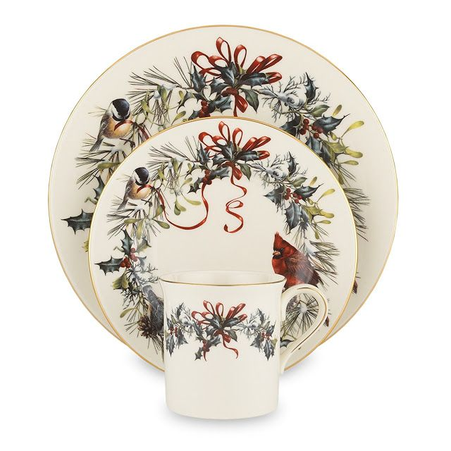 The Lenox Winter Greetings 12-Piece dinnerware set is crafted from Lenox ivory fine china.  Each Winter Greetings plate in this 12-piece set is bordered by a wreath of birds, greenery, and ribbons and trimmed with 24-karat gold for a festive formal look.