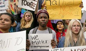 Celeste Ramirez, 20, Erin Ckodre, 21, Ronald Elliott, 18, Patricia Romo, 22, and Rose Ammons, 18, hold up signs during a rally at Texas State University in San Marcos, Texas on Thursday.