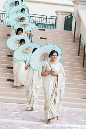Pretty bridesmaids all in a row. The dash of blue was a great idea! --- Indian Wedding