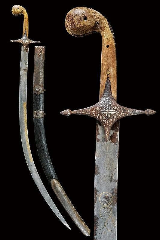 A shamshir with important blade. Curved, flat, damask blade, at the base two cartouches with symbols and letters in Arabic; at the centre a long, gold inlaid inscription in Arabic; silver inlaid, iron hilt with cross quillon, wooden grip scales; wooden scabbard with leather covering and iron mounts decorated en suite. Areas of rust on the blade and mounts.  dating: 18th Century;  dimensions: 96.5 cm.;  provenance: Turkey