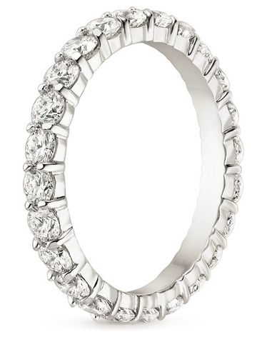This eye-catching eternity band encircles the finger with shimmering diamonds set in beautifully sculpted shared prongs.