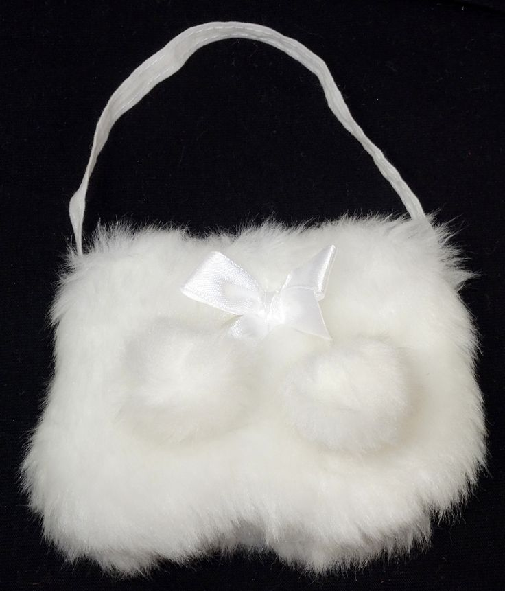 This gorgeous fur handbag features a white satin ribbon bow and two white fur pom poms.  It has a zipper closure and measures 9cm wide, 7cm deep and is 15cm from top of strap to bottom of bag.   It matches perfectly with the white fur trimmed boots.