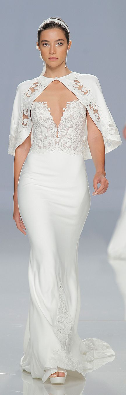 Form-fitting sheath wedding dress with sexy neckline and embroidered bodice paired with a short lace cape // Hola Wedding Scoopers! Last month, we were invited to Barcelona for the second year running, to cover Barcelona Bridal Fashion Week 2017 as an Official Media Partner. We had oh-so-much to share with you across our social media channels over the 4 days and now we're ready to take a more in-depth look at some of our favourite collections on our blog.