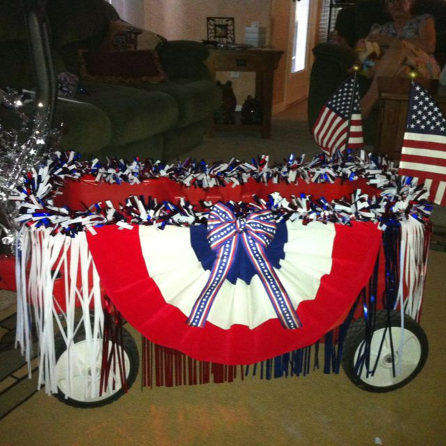 Kid's wagon turned into a parade float:) @Ruth H. Atkins what do you think about this one?