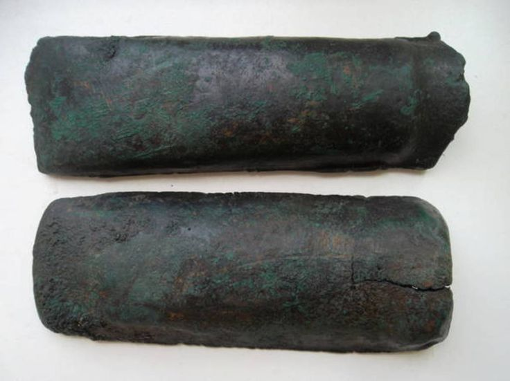 Bronze Age Axe Mould  Period from: BRONZE AGE    Date from: Circa 1100 BC  Date to: Circa 900 BC Primary material: Bronze Sizes: One Piece: 14.8sm length, width 5 cm, weight: 437.2 grams. Second part: length 14 cm width: 5.5sm weight: 374.7. Celt - 3.5 width, length 11 cm. ORIGINAL  Eastern Europe