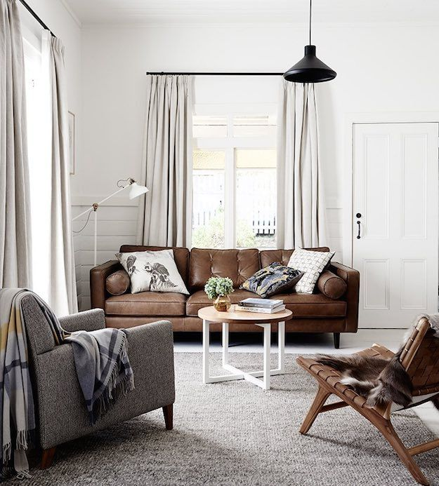 Clean white walls chic ways to style a brown sofa in - White walls living room ...