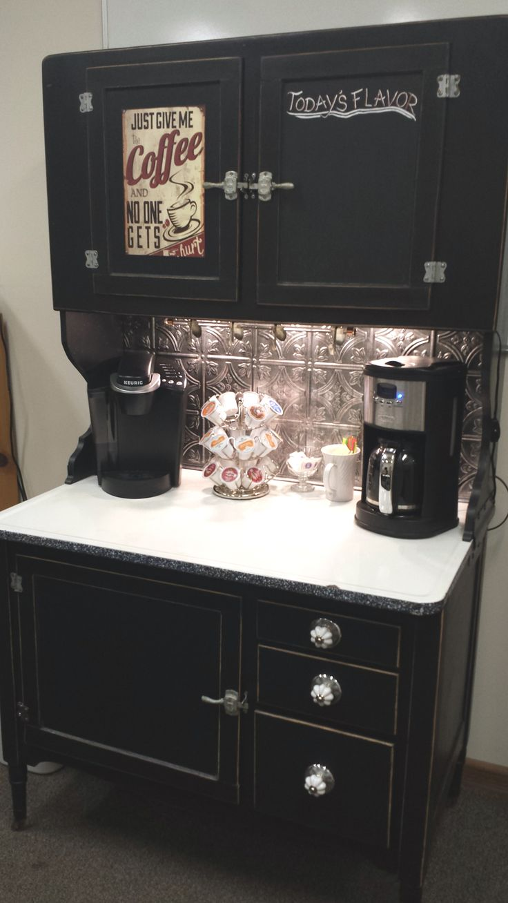 Hoosier cabinet turned into coffee bar. Chalkboard painted door for writing in the flavor of the day.