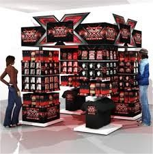 Even x-factor utilises the clever tricks of point of display. This point of display shows x-factor merchandise whilst displaying the show on the tv's this is very effective however it would be a very expensive display to mass produce