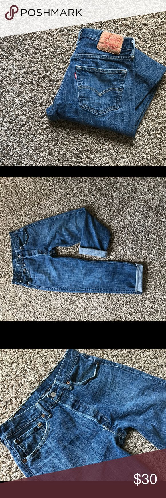 """Vintage Levi's 501 High Waisted Women's Jeans Vintage Levi's 501 High Waisted Jeans - button fly - great condition - I wore them rolled up and are meant to be a tough baggy/boyfriend - tag says 32x32 but, the inseam measured (unrolled) is 27"""" - other measurements are pictured - which makes them perfect for crop style - one paint spot (pictured) gives them character! Levi's Jeans"""