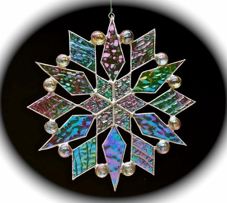 stained glass snowflake suncatcher (design 12). $35.00, via Etsy.