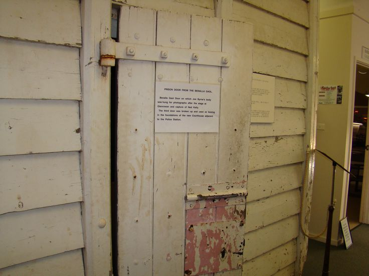 Wooden cell door from lock up at Benalla the very one which Joe Byrnes body was hung from after the Glenrowan siege sot the photographer could get a better shot.