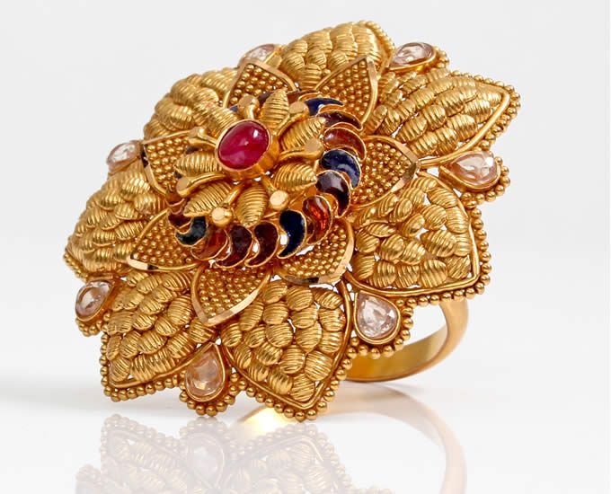 Gold ring from India with Meena ( coloured enamel) work and kundan. Description by Pinner Mahua Roy Chowdhury