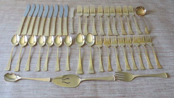Vintage Gold Flatware 40 Piece Set - Golden Barclay Geneve Ribbed - Japan  This is a unique 40 piece vintage set of gold electroplate stainless steel flatware made in Japan. It comes in a brown silver cloth flatware tray that prevents tarnish. The lovely gold ribbed flatware adds a glittering touch to any special occasion.  Dress up your table with this gorgeous vintage set. They are marked Golden Barclay Geneve Japan. The set includes the following:  9 DInner Forks 8 Salad/Dessert Forks 9…