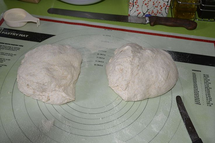 (7) Depending on what you want to end up with, cut the ball of dough to size. Here I want two Boules or Cobs. (Chris S)